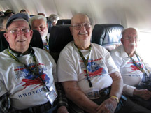 Veterans sit in a plane