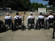 Six veterans in wheelchairs