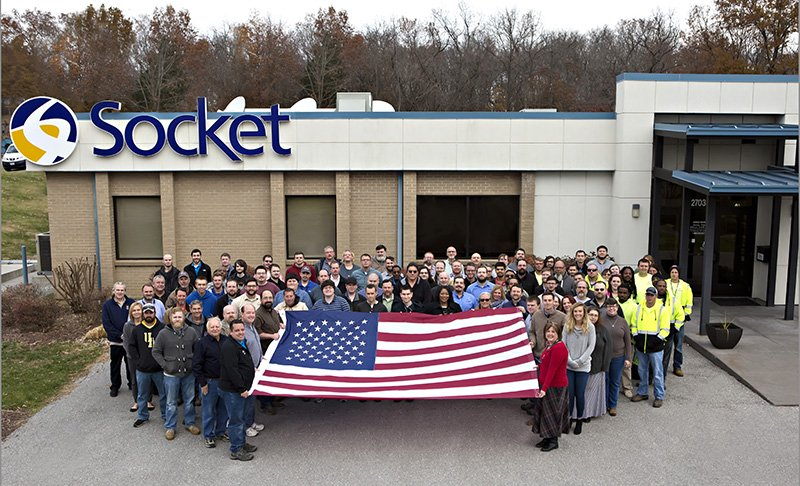 Socket employees hold an American flag
